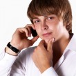 Portrait of young handsome man talking on mobile phone against w — Stock Photo #8063937