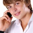 Handsome young guy using a mobile phone — Stock Photo #8063940