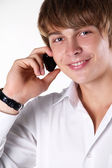 Happy smiling man talking on mobile phone — Stock Photo