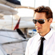 Portrait of Casual man wearing sunglasses,  over yacht outdoors - Stock Photo