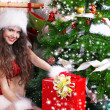 Foto Stock: Portrait of beautiful sexy girl wearing santa claus clothes