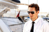 Portrait of Casual man wearing sunglasses, over yacht outdoors — Stock Photo