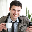 Happy young businessman using mobile phone in business building, — Stock Photo #8255984