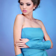 Fashion model, attractive woman in dress on blue bright backgro — Stock Photo