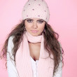 Young beautiful woman wearing winter clothing over pink — Stock Photo
