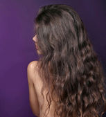 Young woman with beauty curly hairs — Stock Photo