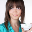 Young woman with a drinking bowl on white background — Foto de Stock