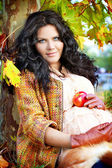 Outdoors portrait of pregnant woman, color autumn — Stock Photo
