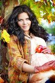 Outdoors portrait of pregnant woman, color autumn — Stock Photo
