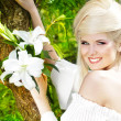 Portrait beauty happy blonde young woman with white lily, nature — Stock Photo #8994338