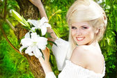 Portrait beauty happy blonde young woman with white lily, nature — Stock Photo