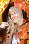 Smiling woman in autumn red leaves. Outdoor. — Stock Photo
