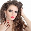 Young beautiful woman with red lips and long curly hairs - isola — Stock Photo