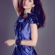 Casual young fashionable woman in dark blue dress — Stock Photo