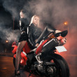 Stock Photo: Young attractive women and motorcycle