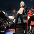 Young attractive woman and motorcycle — Stockfoto