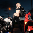 Young attractive woman and motorcycle - Stock Photo