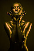 Nude woman like statue in liquid metal — Stock Photo