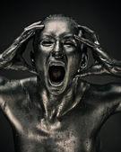Nude woman like statue in liquid metal — Stock Photo
