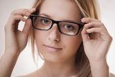 Cute girl wearing glasses — Stock Photo