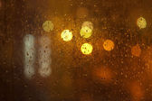 Rainy city window — Stock Photo