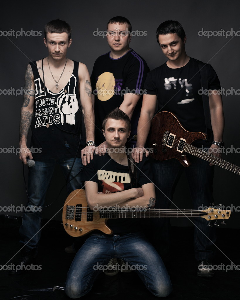 Portrait of rock band on dark gray background — Stock Photo #9817770