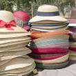 Straw hats stacked on market — Stock Photo #10707724