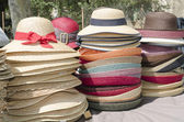 Straw hats stacked on the market — Stock Photo