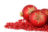 Christmas theme with red balls and red stripes on white background — Stock Photo