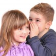 Girl and a boy gossiping — Stockfoto