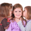 Three girls whisper — Stock Photo