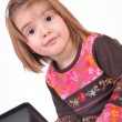 Beautiful little girl with laptop — Stock Photo