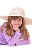 Beautiful little girl with long hair and a hat on a white background — Stock Photo