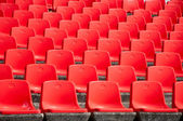 Red stadium seats on the stand — Stock Photo