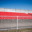 Royalty-Free Stock Photo: Red stadium seats on the stand