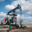 Oil pump jack — Stock Photo #9840583