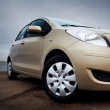 Front-side closeup of a beige car — Stock Photo