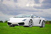 Supercar in golf club — Stock Photo