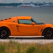 TALLINN, ESTONIA - JUNE 16, 2008: An orange Lotus Exige S side v - Foto de Stock  