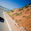 Car driving fast on a road — Stock Photo