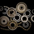 Set of gears, ball-bearings and chain - Stock Photo
