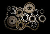 Set of gears, ball-bearings and chain — Stock Photo