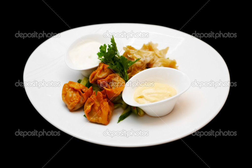 Steamed and deep fried duckleg wontons with soy-sesame mayo isolated on black  Stock Photo #9603354