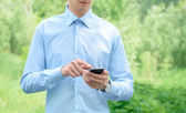 Businessman with mobile phone — Stock Photo