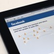 Apple Ipad showing Facebook start page — Stock Photo