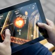 Stock Photo: Play Death Rally on Apple Ipad2