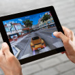 Play Asphalt 6 on Apple Ipad2 - Stock Photo