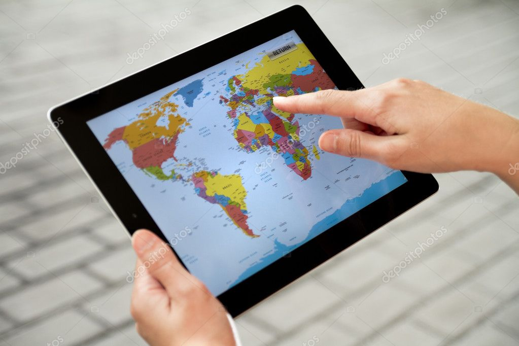 Kiev, Ukraine - July 31, 2011 - A woman using application with world map on Apple Ipad2.  — Stock Photo #8039060