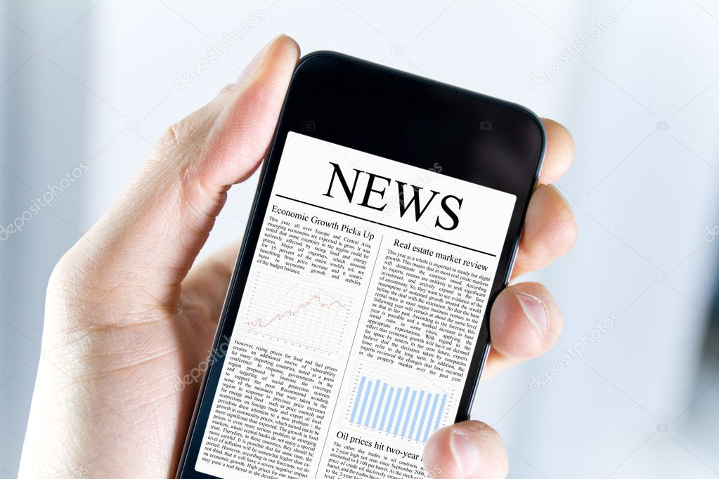 A man holding mobile smart phone with news article on screen. Closeup shot.  Stock Photo #9005456