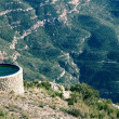 Mountain water tank - Stock Photo